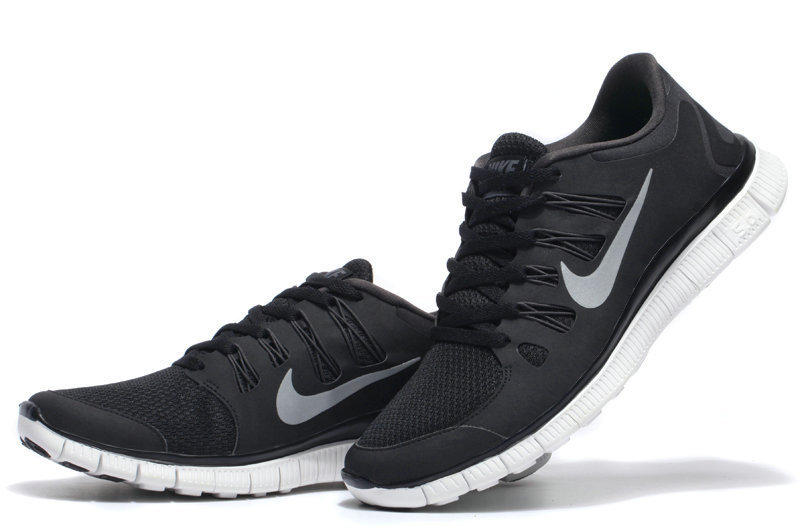 nike womens free runs black and white background